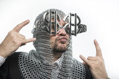 Bank, businessman with medieval executioner in metal and silver Stock Photos