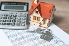 Bank calculates the home loan rate.  royalty free stock photography
