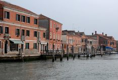 The bank of the canal with houses in Murano in the municipality of Venice in the Veneto (Italy) Royalty Free Stock Images