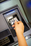 Bank card at an chinese ATM to issue money. Bank card at an ATM to issue money stock photography