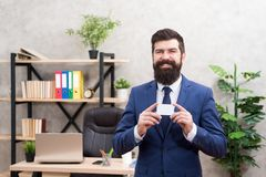 Bank card. Financial support. Bearded hipster top manager hold card. Banking services. Guy formal suit stand in office royalty free stock photography