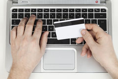 Bank card and laptop Stock Image