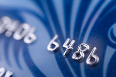 Bank card, macro. A blue bank card, macro, narrow focus royalty free stock photography