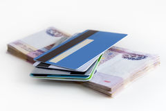 Bank cards in hand on the background of banknote Royalty Free Stock Images