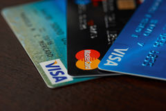 Bank cards laying on wooden background Stock Images