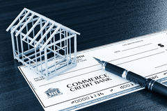 Bank Check with House Frame and pen Stock Photography