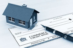 Bank Check with House and pen Royalty Free Stock Image