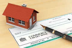 Bank Check with House and pen. On the table royalty free stock image