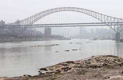Bank. The city is chongqing of china,there are always many fogs around the river,the bridge connects both banks Royalty Free Stock Images