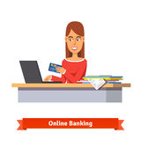 Bank clerk at the table issuing a credit card Stock Image
