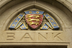 Bank and coat of arms Royalty Free Stock Photography