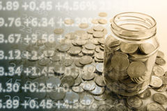 Bank with coins and counting. Close up royalty free stock image