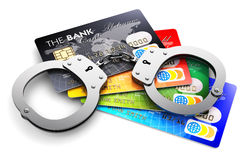 Bank credit cards and handcuffs isolated on white Stock Images