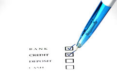 Bank and credit checkbox. Photo Checkbox with pen isolated on white Royalty Free Stock Photography