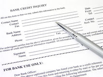Bank Credit Inquiry Form. With a brushed silver and chrome pen Stock Image