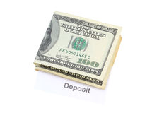 Bank Deposit. A photo of some money with the word deposit underneath it isolated over a white background royalty free stock photography