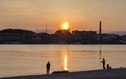 Bank of the Dnieper, Kiev, sunset. Fishermen, spring 2014 Stock Photography