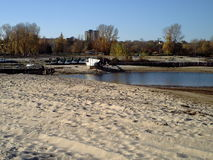 Bank of the Dnieper in Ukraine in Cherkasy early autumn. Boat station after the close of the season, cool sunny autumn day, deserted beach royalty free stock image