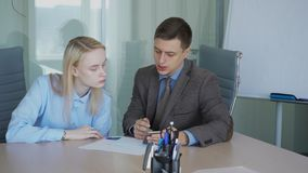 Bank employee introduces a female client to new online program for remote work and payment.  stock footage