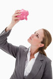 Bank employee looking at piggy bank Royalty Free Stock Photo