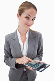 Bank employee with pocket calculator Royalty Free Stock Photos