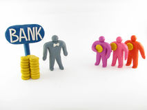 Bank employee and three men. Three potential clients have brought some cash to a bank. The bank employee meets them Royalty Free Stock Image