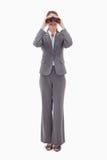 Bank employee using binoculars Stock Photo