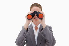 Bank employee using spy glasses Royalty Free Stock Photos