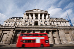 Bank of England. With motion blur of passing double decker red bus London, England royalty free stock photo