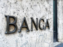 Bank entrance sign marble wall. Bank Banca in italian entrance with sign on marble wall Royalty Free Stock Photography