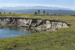 Bank erosion, pasture along Buffalo Fork River, Moran, Wyoming. Stock Photography