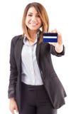 Bank executive giving you a credit card Royalty Free Stock Photography