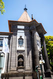 Bank Facade in  the centre of Funchal on the Island of Madiera. Funchal is the Capital of the island of Madeira. The distinctive houses and roofs seem to pile on Stock Images