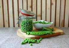 Bank, filled with peas Royalty Free Stock Images