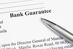 Bank Guarantee. Macro shot of Bank Guarantee with pen in focus - many uses in finance and banking Royalty Free Stock Image