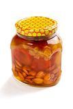 Bank of honey with the candied fruit and nuts Stock Images
