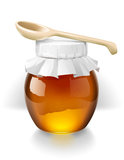 Bank of honey with a wooden spoon Stock Photo