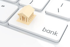 Bank icon on the white computer keyboard. E-bank concept. 3d rendering of bank icon on the white computer keyboard. E-bank concept Stock Photos
