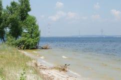 Bank of the Kakhovske reservoir. With broken tree Royalty Free Stock Photos