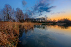 Bank of a lake in the winter during sunset Stock Photo