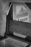 Bank Ledger. Ledger and bank check in monochrome - aged image Stock Photo