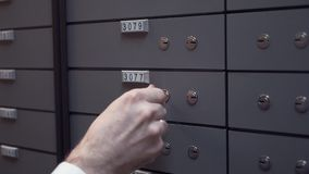 Bank manager hands with client old man closing up safe cell using two keys stock video