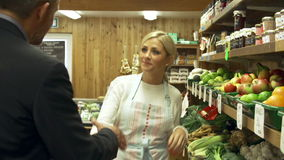 Bank Manager Meeting With Female Owner Of Farm Shop. Bank manager vists owner of farm shop and asks her questions.Shot on Sony FS700 in PAL format at a frame