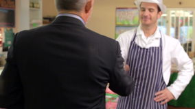 Bank Manager Meeting With Owner Of Butchers Shop stock video footage