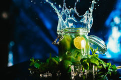 Bank mojito with lime and mint ice cube falling splash stock photos