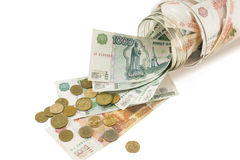 Bank with money, dollars , euros and scattered coins Stock Photos