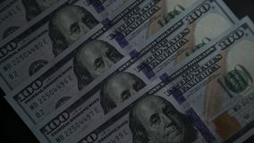 Bank and money. Monetary system of the country. American Dollars. American Dollars: banknote 100. President Benjamin Franklin on a bill. Several banknotes with a stock video footage