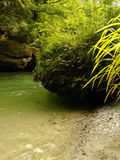 Bank of the mountain river with huge boulders Royalty Free Stock Photography