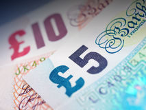 Bank Notes. Bank note focusing on £5 and £10 Stock Images