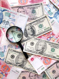 Bank notes background. A photograph of many colorful money paper notes from different countries like united states, China, Singapore.  Taken with a magnifying Royalty Free Stock Photos